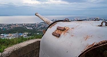 An old abandoned gun battery aiming at the bay in Vladivostok, Russia