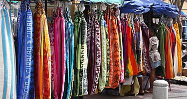An assortment of dresses for sale at a market