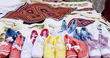 Table cloths and knit goods at a street market in Croatia