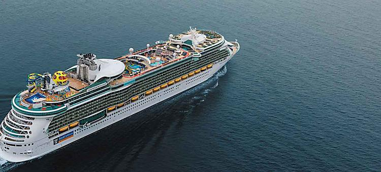 Aerial view of Independence of the Seas as it sails out into the ocean