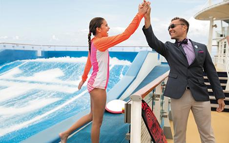Genie high fiving girl on the Flowrider