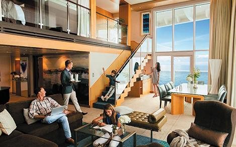 A family in the living room in the Royal Suite Class