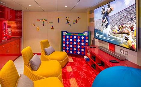 The game room with movies and toys in the Ultimate Family Suite