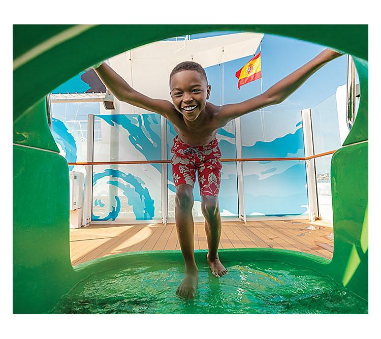 Kid going in a slide onboard Allure