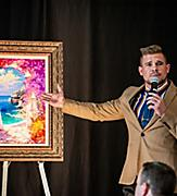 Man Auctioning Painting