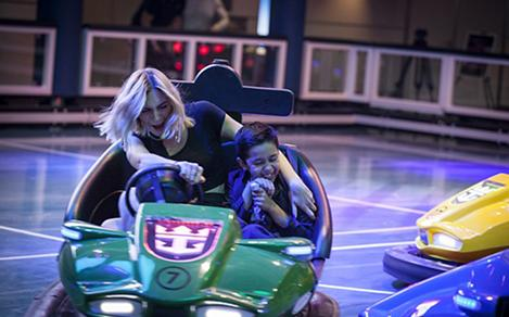 Mon and Son Driving and Enjoying the Bumper Cars