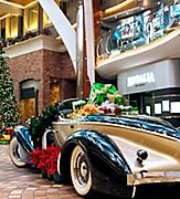 Presents and Christmas Decorations around Vintage Car