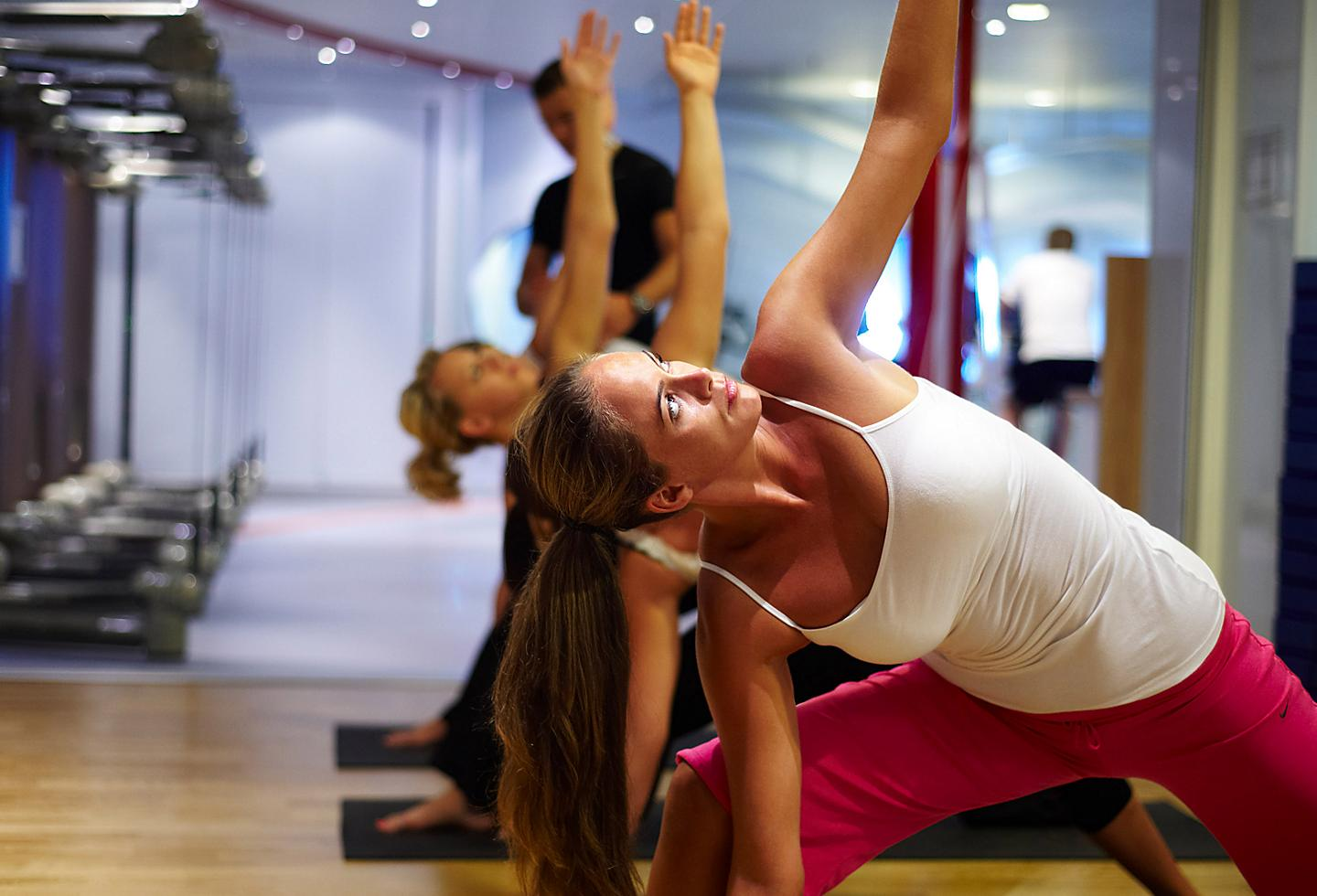 Guest Enjoying Yoga Class with Instructor