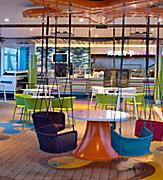 plashaway Cafe Interior with Swinging Colorful Chairs