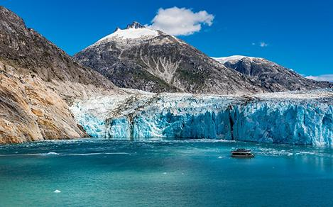 Glacier View of Boat and Snow Capped Mountain
