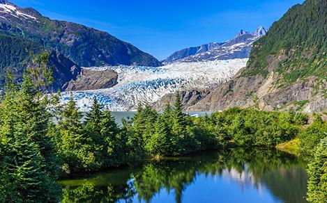 Scenic Views of Mendenhall Glacier with Trees by the Lake