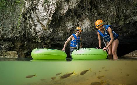 Couple entering a Natural Lazy River in a Cave