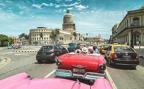 Vintage Cars in a Popular Street in Cuba