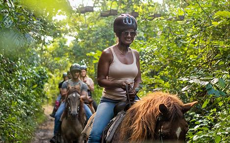 Tourist Riding Horses in the Jungle
