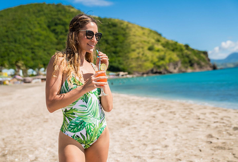 Girl drinking cocktail on Basseterre St Kitts Golden Beach