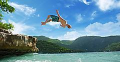 Man Jumping into Ocean in Jamaica