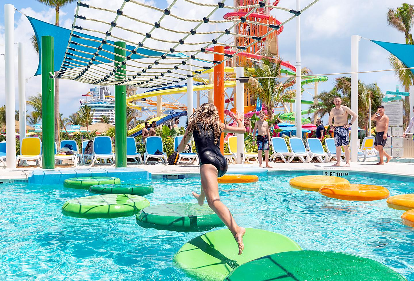Perfect Day Coco Cay Girl Jumping on Obstacle Course