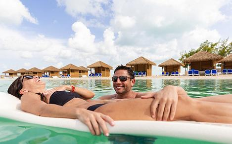 Chill Cabanas Couple Floating in the Ocean