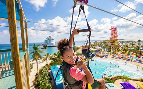 Perfect Day Coco Cay Girl Zip Line with Navigator of the Seas in Background