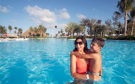 Mom and Son Enjoying Oasis Lagoon