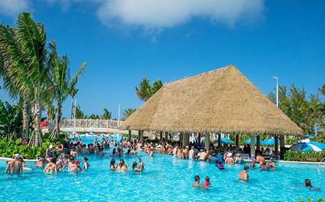 Guests Enjoying the Swim Up Bar at Oasis Lagoon
