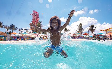 Perfect Day Coco Cay Tidal Wave Pool Boy Jumping