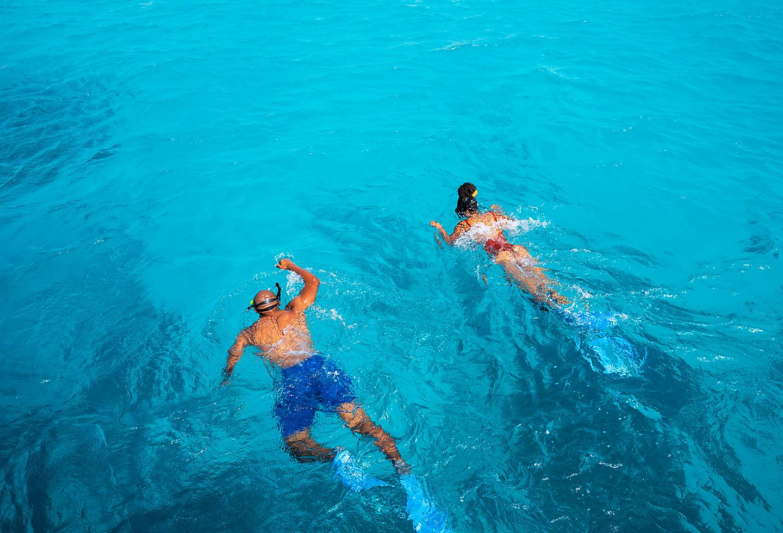 Bonaire Couple Snorkeling in clear ocean water