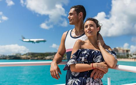 Couple Watching Airplanes Land in St Maarten