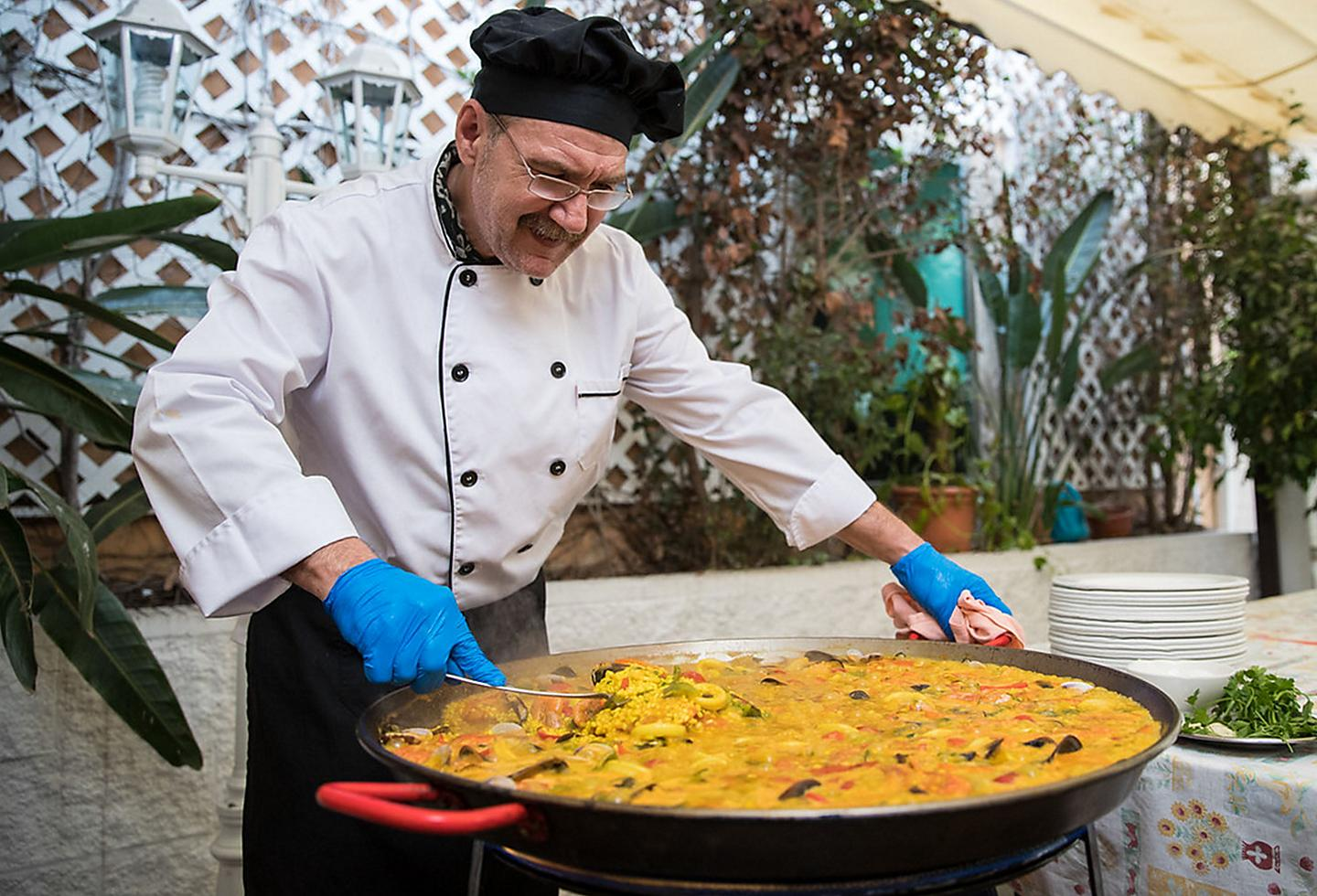 Spain Local Chef Cooking Paella