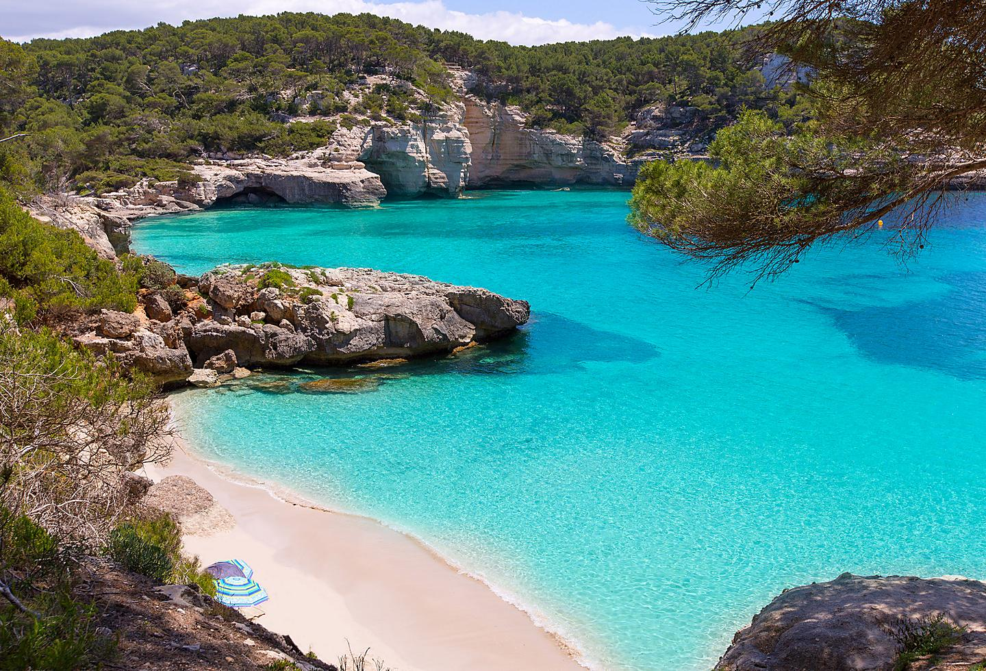 Spain Menorca Cala Mitjaneta Beach Cliffs