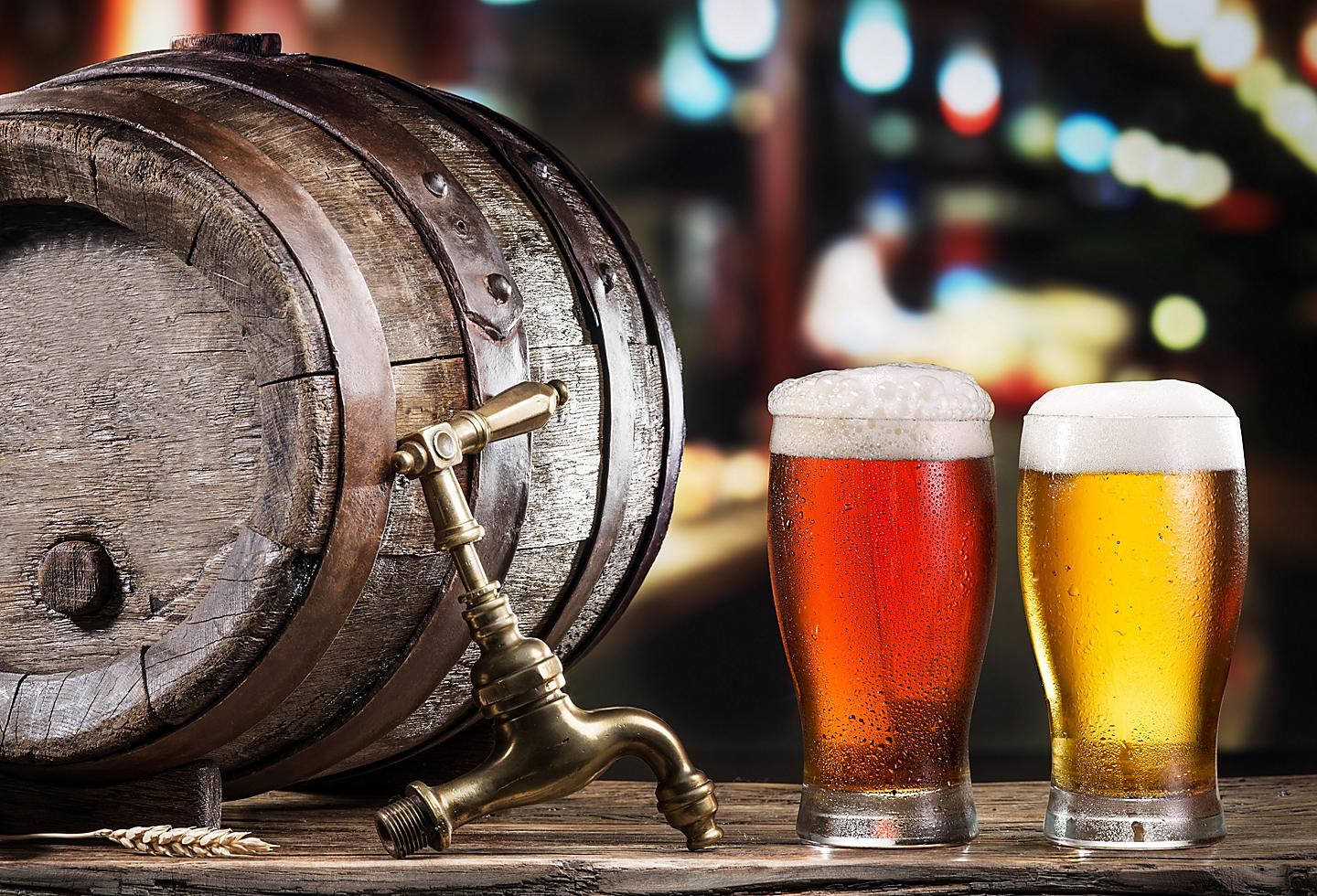 Glasses of Beer and Barrel at Dry River Brewing