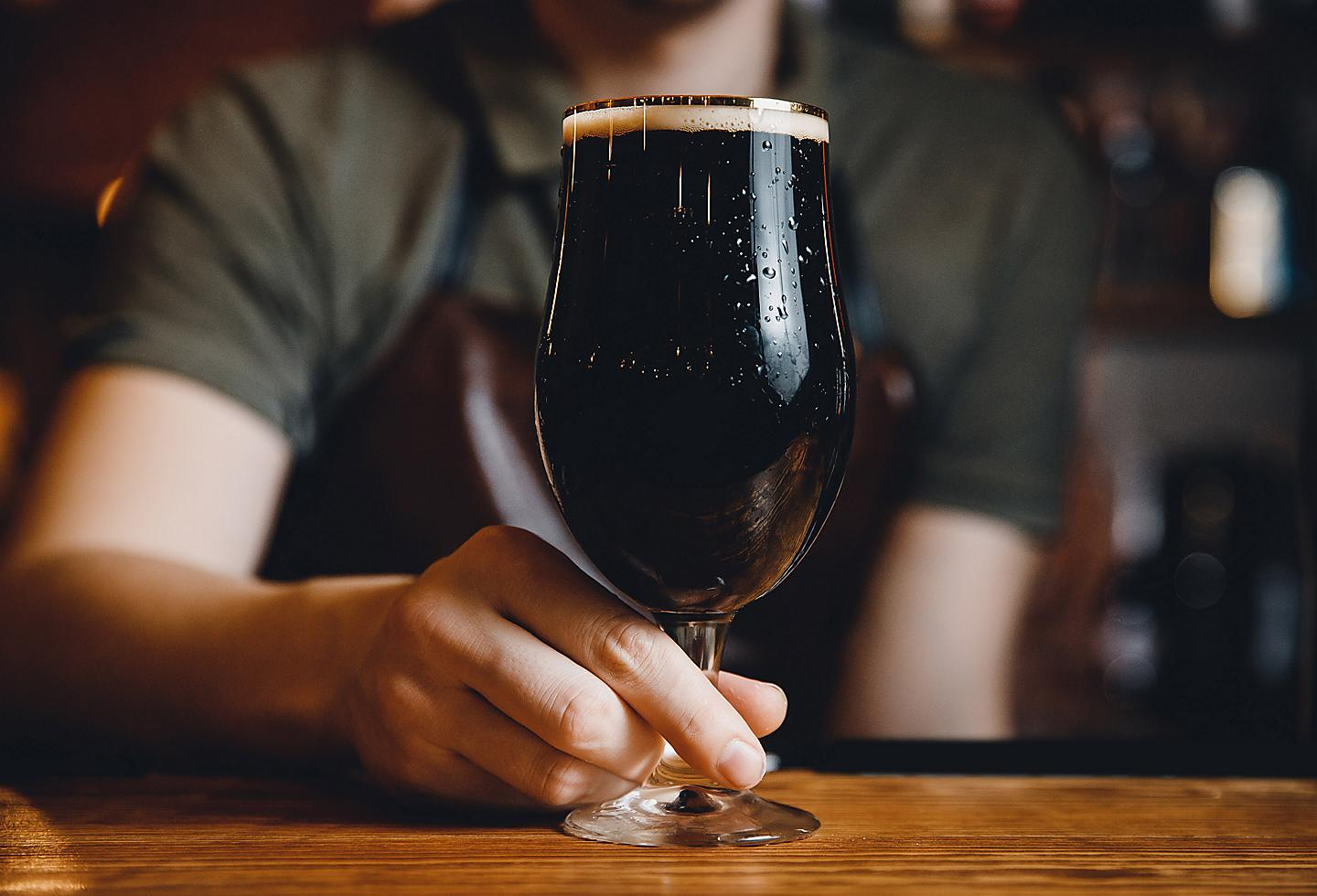 Man with Dark Beer at Angel City Brewery