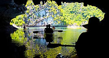 Silhouettes Couple Kayaking Inside a Cave