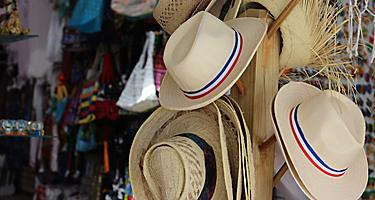 Sale of hats in a gift shop at the Bayahibe beach