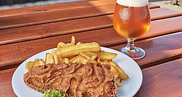 Fish and chips plate and a glass of beer