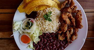 Nicaragua typical plate. Meat with rice and beans