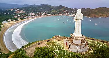 Famous Jesus statue. Aerial view on San Juan del Sur city in Nicaragua.