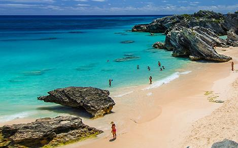 People on the beach at Kings Wharf, Bermuda. Top destination for a tropical family sailing cruise vacation.