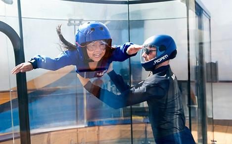 Girl with instructor, floating in the Ripcord by iFly