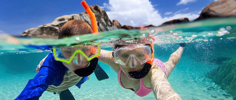 Mother and Son Snorkeling and Taking a Selfie
