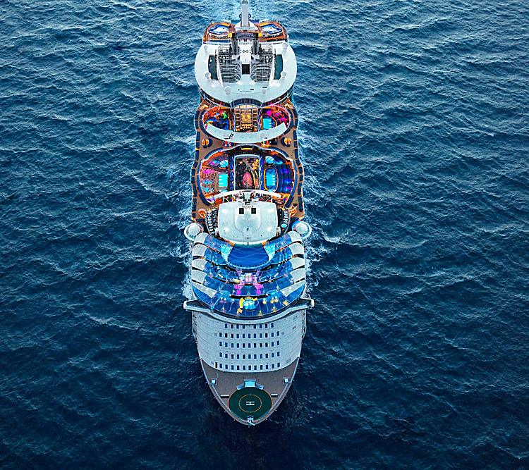 Aerial view of Symphony of the Seas sailing away in the ocean