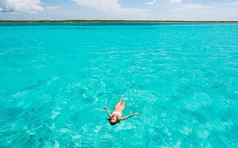 Woman Relaxing and Floating in Caribbean Waters